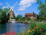Windmill and House By The River