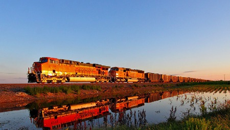 Train Twins - water, sunset, train, red