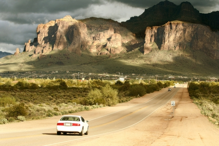 Superstition Mountains - mountains, peaks, shadows, road, clouds, sky, landscape