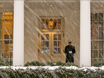 Snowfall with Marine Guarding White House Entrance