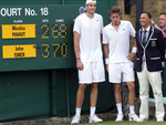 John Isner, Nicolas Mahut & Umpire standing next to the historic scoreboard after the longest match in Open history.