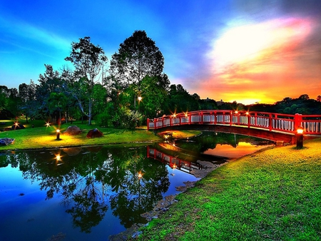 Beautiful Place - architecture, red, pretty, colorful, grass, beautiful, sunset, clouds, lights, splendor, bridge, green, beauty, river, evening, reflection, other, blue, lovely, view, colors, park, sky, trees, lake, water, peaceful, nature