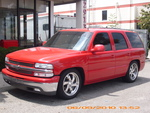 RED CHEVY TAHOE