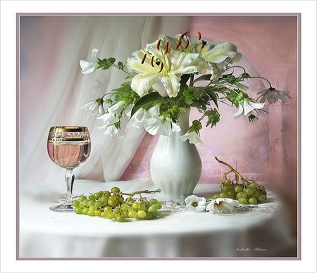 Tasteful - table, trim, wine, fruits, vase, beautiful, tablecloth, grapes, white wine, lillies, gold, nice, green, flowers, wineglass, white
