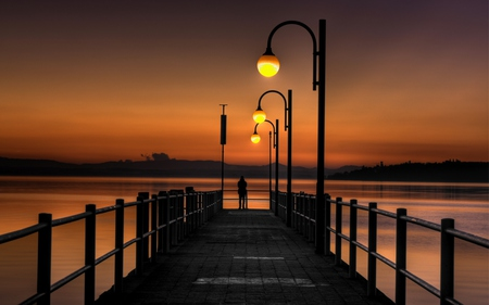 Watching The Sunset - lantern, colourful, beautiful, sunset, clouds, sea, lights, splendor, bridge, pontoon, beauty, evening, lanterns, lovely, romantic, view, romance, ocean, pier, colors, sky, light poles, water, girl, jetty, peaceful, nature