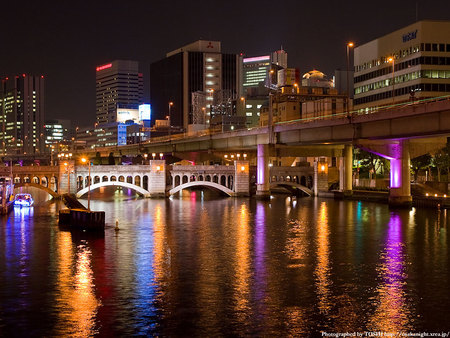 well lit city - architecture, pretty, buildings, lights, skyscrapers, city, water, bridge, reflections, pink, manmade