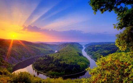 Beautiful Place - colorful, sunlight, peaceful, glow, sun, forest, dazzling, saar, sunrise, hill, horizon, flowers, saarschleife, sky, water, summer, scene, woods, reflection, scenery, rays, clouds, photography, shine, stream, germany, tree, island, landscape, mountain, sunset, colors, splendor, trees, meandering, nature, beauty, beautiful, lovely, sundown, river, green, riverbank, view, bushes, photo