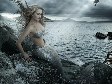 A Mermaid - shore, rocky, dusk, beautiful, overcast, abstract, clouds, photography, mermaids, surreal, sunbeam