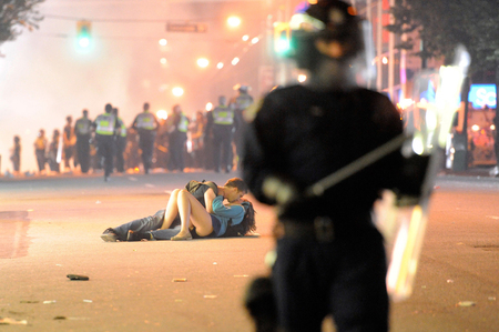 Kissing Couple During Chaos In Vancouver B.C. Riot  June 15th 2011 Following Game 7 of Stanley Cup Finals. (  Courtesy The Globe and Mail  )
