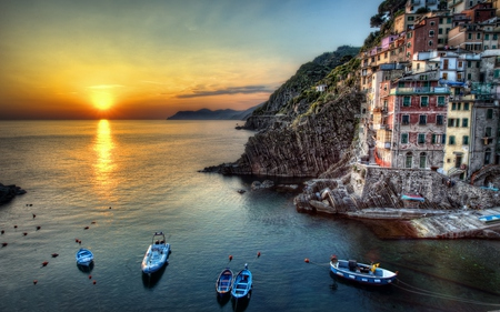 Riomaggiore,Italy - rocks, house, sun, sunset, clouds, boat, italia, boats, splendor, beauty, reflection, italy, lovely, houses, buildings, sky, trees, water, rays, hillside, landscape, colorful, riomaggiore, beautiful, cinque terre, sea, amazing, view, sunlight, colors, tree, peaceful, nature