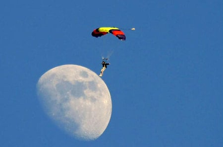 Parachutist landing on the moon - moon, other, sky, man