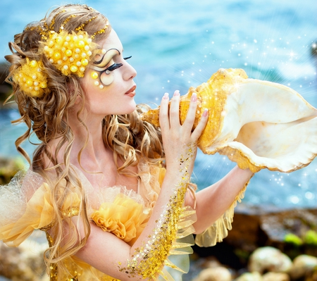 Beautiful Mermaid - yellow, beautiful, woman, sea, sweet, hair, she, fantasy, people, beauty, face, female, lovely, ocean, mermaid, lips, hands, girl, shell, makeup, nature, shells, eyes