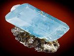 EXCEPTIONAL! A large doubly terminated Aquamarine crystal atop Muscovite!