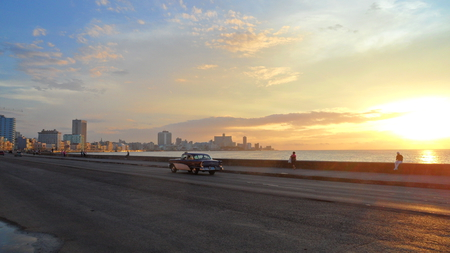 Sunset on the Malecon - cuba, orange, car, havana, sunset, reflections, sea, blue