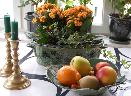 orange and yellow - flowers, candles, plate, candle, yellow, andlestick, orange, still life, basket, fruits