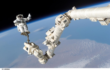 COSMONAUT IN SPACE - spacecraft, cosmonaut, space shuttle arm, space