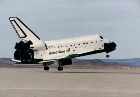 THE SHUTTLE TOUCHES DOWN - shuttle, landing, nasa, spacecraft