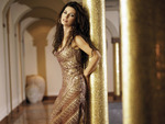 Shania Twain posing in gold