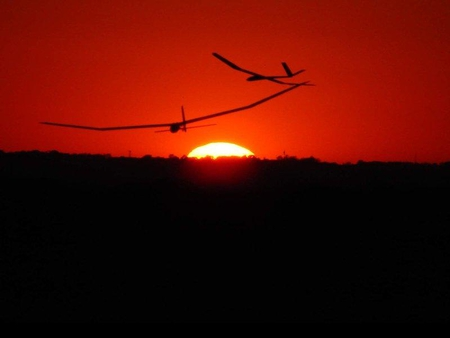Gliding at Sunset - gliders, red, sunset, night
