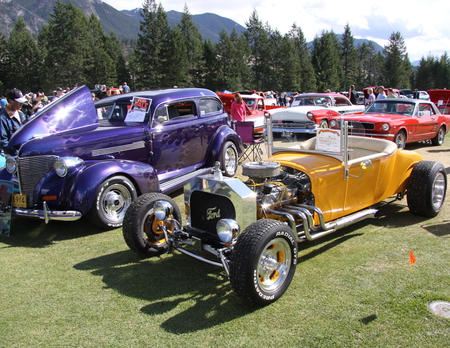 1926 Ford at the  Radium Hot Springs car show 75  - white, Engine, car, tree, red, tires, nickel, Chrome, Ford, mountains, Photography, yellow, purple, Headlights, clouds, green, silver, black
