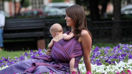 Lovely Mom - lovely, mom, beautiful, smiling, carrying, brunette, purple, flowers, sitting, child