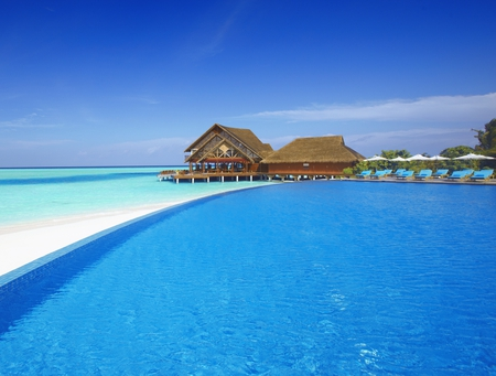 Just Another Day In Paradise - resort, summer time, umbrella, beautiful, clouds, sea, beach, maldives, splendor, chairs, beauty, chair, swimming, blue house, umbrellas, lovely, view, holiday, houses, ocean, swimming pool, pier, sky, pool, paradise, peaceful, summer, nature, villas