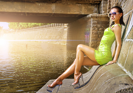 lime green dress - female, sun, woman, heels, sexy, brunette, photography, water, green, bridge, nature, sunshine