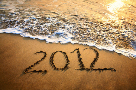 Happy 2012 - ocean, 2012, shine, beautiful, new year, suds, beach, sunrays, sand, water, peaceful, writing