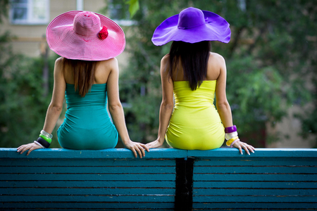 Hot Girls on a Bench - purple, hot, bench, sitting, girls, pink, blue, hat