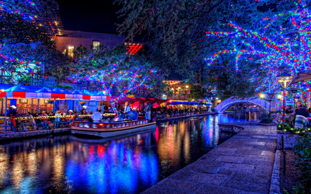 Christmas Lights - colorful, peaceful, building, walk, path, lights, xmas, christmas lights, night, merry christmas, water, happy holidays, reflection, romance, city, buildings, house, people, lanterns, christmas, lake, town, romantic, magic, tree, lantern, new year, boat, holiday, restaurant, way, blue, colors, bridge, splendor, magic christmas, trees, boats, nature, terrace, architecture, beauty, beautiful, lovely, houses, pretty, happy new year, view