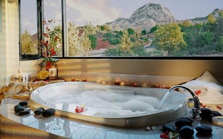 Romantic bath - rocks, bath, mountain, flame, stones, bubbles, flowers, light, aromatic, window, romantic, view, romance, suds, roses, trees, candles, fire, tub, water, aromtherapy, petals, relaxing, bath room