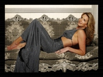 Penny Lancaster Laying On A Sofa