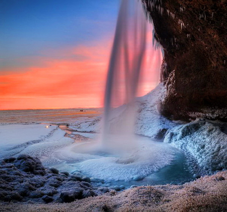 Iceland beauty - sunset, ocean, cliff, foam, coral sky