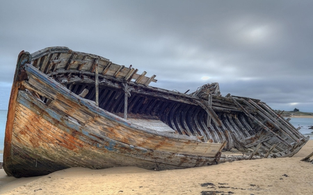 Abandoned Boat - beach, cloudy, boat, broken, weathered, wooden, coast, abandoned