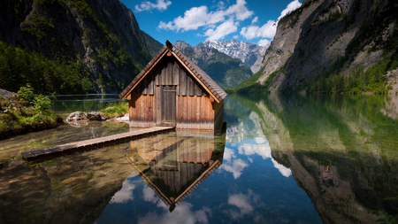 Cabin close the mountains - grass, cabin, trees, clouds, lake, mountains, plants, blue sky, reflected