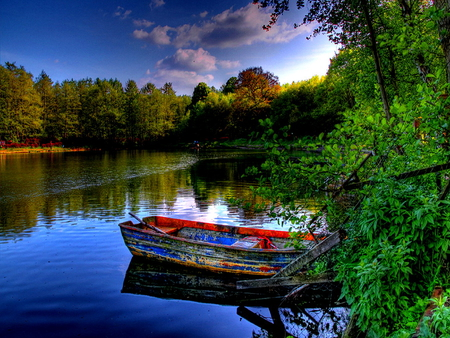 Boat in mirrored waters - lonely, trees, sky, clouds, lake, pond, waters, boat, calm, summer, peaceful, nature, river, reflection